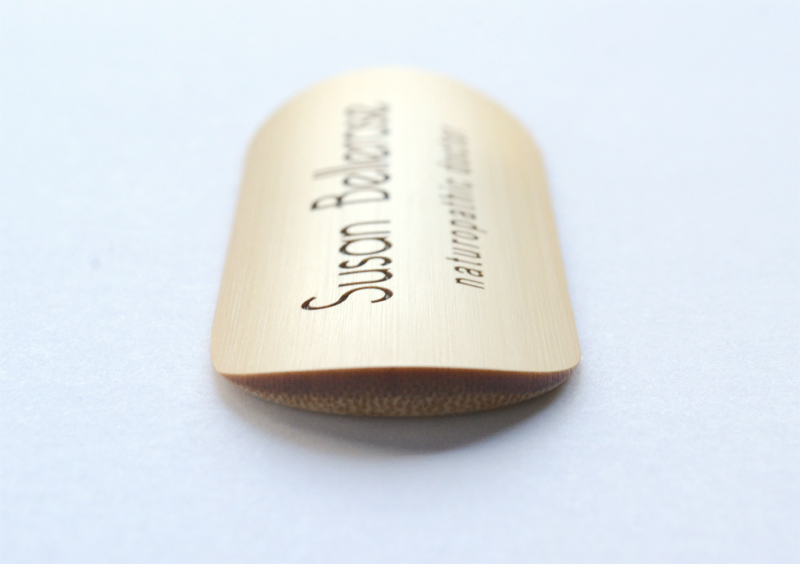 Side view of curved bamboo name tag