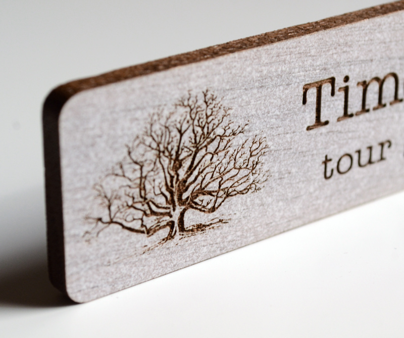 Close-up engraved walnut name tag